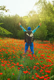 Happy woman among field of blooming poppies Royalty Free Stock Photography