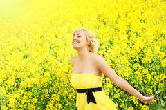 Happy woman on the field of flowers Stock Image