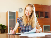 Happy woman fills in the questionnaire Stock Photography