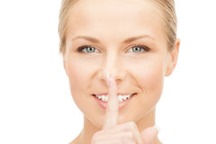 Happy woman with finger on lips Stock Image