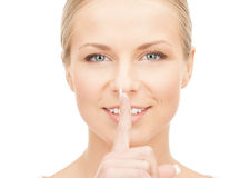 Happy woman with finger on lips Stock Photo