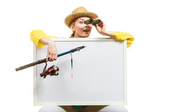 Happy woman with fishing rod holding board. Fishery, spinning equipment, angling sport and activity concept. Happy woman with fishing rod and binoculars holding royalty free stock images