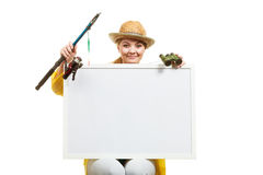 Happy woman with fishing rod holding board. Fishery, spinning equipment, angling sport and activity concept. Happy woman with fishing rod holding blank white royalty free stock images