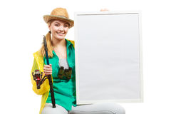 Happy woman with fishing rod holding board Stock Photo