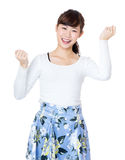 Happy woman fist up. Isolated on white Royalty Free Stock Images