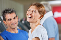 Happy woman in fitness center Royalty Free Stock Photo
