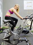 Happy woman in fitness center Stock Image