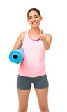 Happy Woman With Fitness Mat Gesturing Thumbs Up Stock Photo