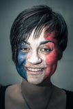 Happy woman with flag of France on face Royalty Free Stock Photo