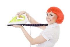 Happy woman flattening tie Stock Photo