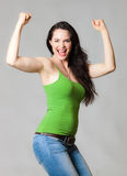 Happy woman flexing muscles royalty free stock images