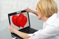 Happy woman flirt online. Happy blonde woman find love online, flirt royalty free stock photo
