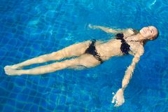 Happy Woman Floating In Pool Royalty Free Stock Photography