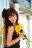 Happy woman with a flower Royalty Free Stock Photo