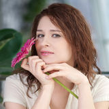 Happy woman with flower at dating Royalty Free Stock Photography