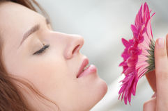 Happy woman with flower at dating Stock Photos