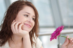 Happy woman with flower at dating Royalty Free Stock Photos
