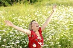 Happy woman in flower field Stock Photo