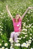 Happy woman in flower field Royalty Free Stock Image