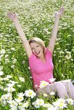 Happy woman in flower field Stock Images