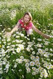Happy woman in flower field Royalty Free Stock Images
