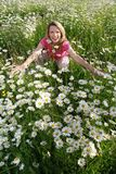 Happy woman in flower field Royalty Free Stock Photography