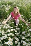 Happy woman in flower field Stock Image