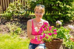 Happy woman in flower garden Royalty Free Stock Photos