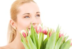 Happy woman with flowers Royalty Free Stock Images