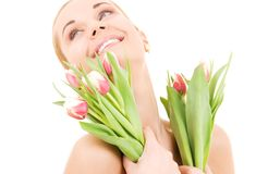 Happy woman with flowers Stock Images