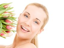 Happy woman with flowers Royalty Free Stock Photo