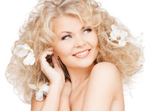 Happy woman with flowers in hair Stock Photography