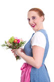 Happy woman with flowers - isolated - in dirndl dress Royalty Free Stock Image