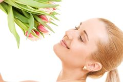Happy woman with flowers Stock Photos