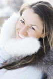 Happy woman in fluffy mittens Royalty Free Stock Images
