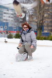 Happy woman  among the flying ducks. Happy woman in the winter among the flying ducks Royalty Free Stock Images