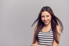 Happy woman with flying hair Stock Photography