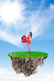Happy woman on flying island Royalty Free Stock Photos