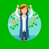Happy woman with  flying money. Stock Photo