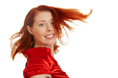 Happy woman with flying red hair Royalty Free Stock Image