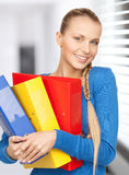 Happy woman with folders Stock Images