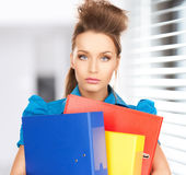 Happy woman with folders Stock Photo