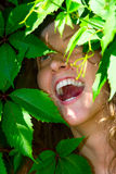 Happy woman in foliage Stock Image