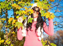 Happy woman with foliage in autumn Royalty Free Stock Photo