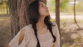Happy woman in forest enjoying nature. Cute young girl walking outdoors stock video footage