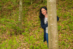 Happy woman in forest Stock Photo