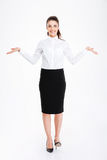 Happy woman in formalwear holding copy space in both hands Royalty Free Stock Image