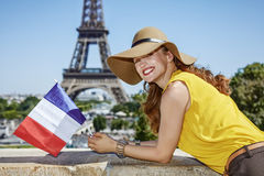 Happy woman with French flag in front of Eiffel tower in Paris Royalty Free Stock Images