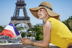 Happy woman with French flag in front of Eiffel tower in Paris Stock Photography