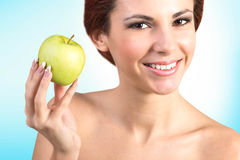 Happy Woman with fresh apple. Stock Image